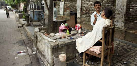 A street barber in Kolkata, India. It is estimated that the city has nearly 2m street traders (Photo: Nicolas Mirguet, Creative Commons via Flickr)