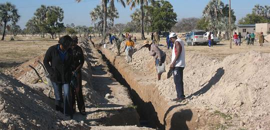 Residents of Tsandi, a settlement in the Omusati region of northern Namibia, look at the community-led sanitation installation for houses being built by the Shack Dwellers' Federation of Namibia (Photo: Diana Mitlin/IIED)