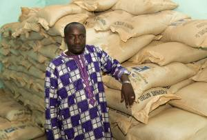 Ogobara Kodjo, the fertiliser company representative in Sélingué, with sacks of phosphate fertiliser (Photo: Mike Goldwater/GWI)