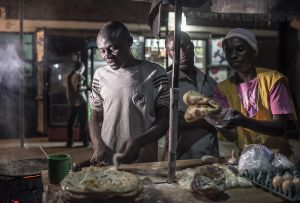 Chris employs two people at his chapatti stall on the main road of Fort Portal. With the profit he can sustain his family and rent his home (Photo: Sven Torfinn/Panos Pictures)