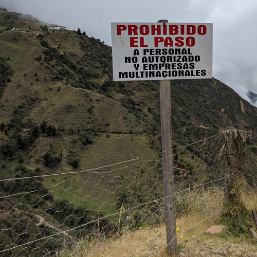 A sign on a hillside reads 'No entry for unauthorised personnel and multinationals'