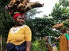 Women carrying logs on their heads