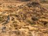 Aerial view of hundreds of men and women tin mining