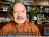 Head and shoulders image of Sonam P Wangdi, in traditional Bhutanese attire, speaking into a video camera