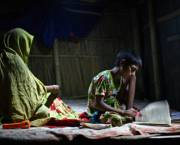 Low-cost solar lanterns enable a boy to study at home in the small village of Shidhulai in the Natore District of northwestern Bangladesh (Photo: G.M.B. Akash/PANOS)
