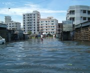 Flooded street with tall buildings in the background