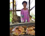 A woman stands in front of one of the new enclosed clay stoves (Photo: Duncan Macqueen/IIED)