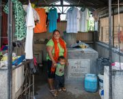 A family living in a cemetery in Cebu City, the Philippines. A lack of affordable housing has led some 100 families to set up home among the mausoleums (Photo: Karl Fluch, Creative Commons via Flickr)