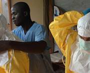 Care workers in Guinea put on protective clothing (Photo: EC/ECHO)