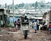 An image of a man with a wheelbarrow in the Kibera informal settlement in Nairobi, Kenya, the biggest in Africa and one of the biggest in the world. The rights of all must be incorporated into the 'new urban agenda' (Photo: Steffan Jensen/www.reversehomesickness.com, Creative Commons, via Flickr)