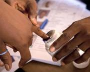 A person's baby finger is covered in ink so they can vote during the 2013 Presidential elections.