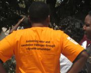 The slogan on a woman T-shirt in Kitwe, Zambia - emblazoned with 'Addressing water and sanitation challenges through city-wide partnerships' - highlights the community-led approach (Photo: Diana Mitlin/IIED)