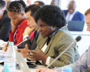 Stella Gama of Malawi at a desk speaks into a microphone as she briefs the Technology Executive Committee