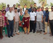 An image showing a group photo of CBA10 field trip group posing for a photo on a rooftop at the end of a long day during which the delegates made visits to four separate projects in Dhaka where communities are adapting to climate change (Photo: Matt Wright/IIED)