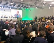 Hordes of journalists gather at a packed press conference to listen to the High Ambition Coalition in Paris in 2015