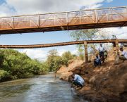 Testing the water in Kenya's Tana River watershed. The river's ecosystem is being affected by a range of factors. Public and private organisations are exploring ways to improve ecosystem management (Photo: Georgina Smith/CIAT, Creative Commons via Flickr)