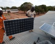 An image showing two men on the roof of a school in Zambia carrying out a macrosolar installation. Sustainable energy solutions for Least Developed Countries were discussed at the event in London (Photo: Steve Woodward)