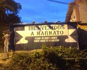 "A canopy above the entrance to a mine. Written on the canopy is 'Bienvenidos a Marmato"" - welcome to Marmato"