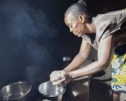 Esther Atieno prepares dinner for her family in Kisumu City, Kenya, using a jiko kisasa (firewood stove). Without city-wide data on electricity and fuel use available from utilities and companies, cities can survey a set of households on their energy use and extrapolate the results (Photo: Peter Kapuscinski/World Bank)