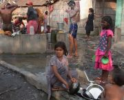 Washing in Kolkata. Urban poor groups must engage with city government and utility companies in order to become drivers for change (Photo: Wolfgang Sterneck, Creative Commons via Flickr)