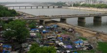 There is often very little data available about people living in informal settlements such as these along the riverfront in Ahmedabad in India (Photo: Emmanuel Dyan, Creative Commons via Flickr)