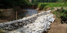 sandbags holding back river water