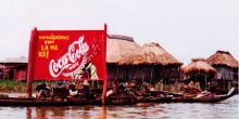 A Coca-Cola sign outside a small town in Benin. Bloomberg's new health initiative will support cities to reduce the consumption of sugary drinks, but this isn't the biggest health challenge facing low-income urban residents (Photo: Lorena Pajares, Creative Commons via Flickr)