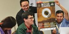 Bolivian family farming organisations show a poster about their award-winning coffee business development activity at the World Rural Forum in Bilbao, Spain (Photo: Duncan Macqueen/IIED)