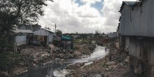 Water with open sewage is stagnant in a built up area