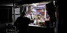 A vendor in India uses energy produced by a micro-grid funded by SunFunder (Photo: Sameer Halai/SunFunder)