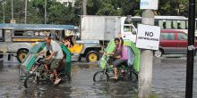 Pedicabs on the flooded streets of Manila, Philippines.