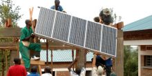 Installing solar panels in Rwanda. Photo: Solar Electric Light Fund (SELF)