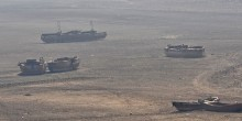 Ships lay stranded in a dry reservoir in China.