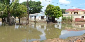 View of a flooded road and houses