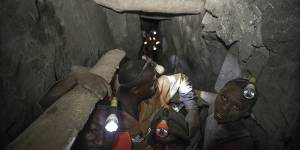 Employees work deep within a tunnel at the Nsangano Gold Mine, Mawemeru village in Geita District, Tanzania in March 2015 (Photo: Brian Sokol/Panos Pictures)
