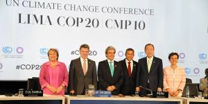 COP20 chair Manuel Pulgar Vidal, centre, was highly praised for his efforts to produce the Lima Call for Climate Action