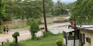 """Flooding in Fiji. Fiji's prime minister has said the his nation is in """"a fight for survival"""" as climate change brings almost constant cyclones. (Photo: TC Evans/Fijian Government)"""