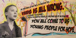 "An image of youth climate leader Greta Thunberg on a mural, with her speech: ""You all come to us young people for hope. This is all wrong"""