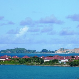 Landscape of an island with houses and vegetation surrounded by the sea
