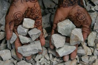 Mwanahamisi Mzalendo with limestone in her hands