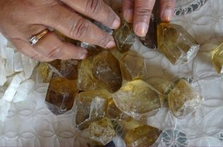 Shamsa Diwani assesses the rough cut stones