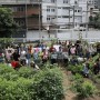 Aerial view of people in an urban garden, waving.