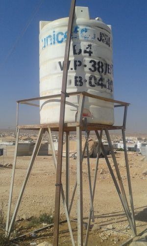 A water tank provided by UNICEF and its partners in Za'atari camp. Due to prolonged crises, supporting organisations have aimed at addressing local capacities as much as urgent needs (Photo: Loan Diep)
