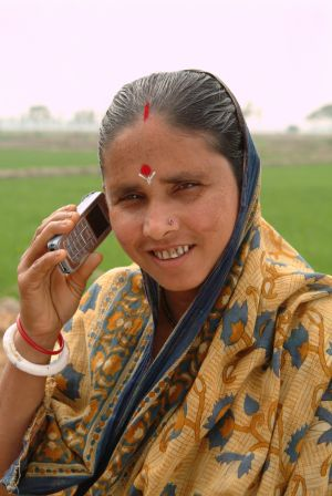 A farmer using a mobile phone. (Photo: Practical Action)