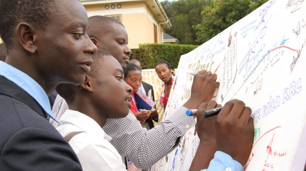 Uganda food lab participants add their names to a declaration that came out of the lab discussions (Photo: Nimrod Bagonza)