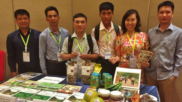 The Forest and Farm Facility Vietnam team displays new forest and farm products and knowledge from work with Forest and Farm Producer Organisation businesses (Photo: Duncan Macqueen/IIED)