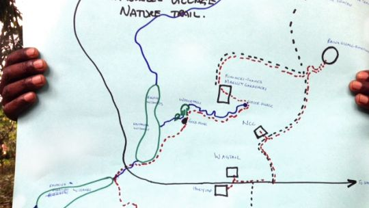 A map shows new walking trails at the edge of the park that have been developed to encourage tourists to explore more of Bwindi and spend money on local products (Photo: Peter Nizette)