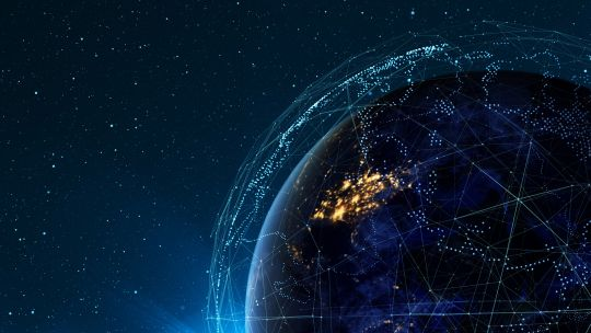 This illustration shows Earth encircled by digital networks. New digital data storage and sharing platforms are revolutionising financial operations (Image: Chani Goering, Creative Commons via Flickr)