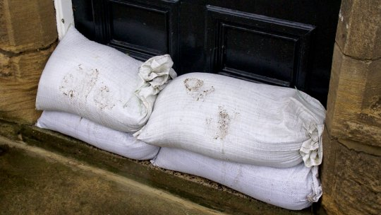 Sandbags in a doorway to prevent flooding