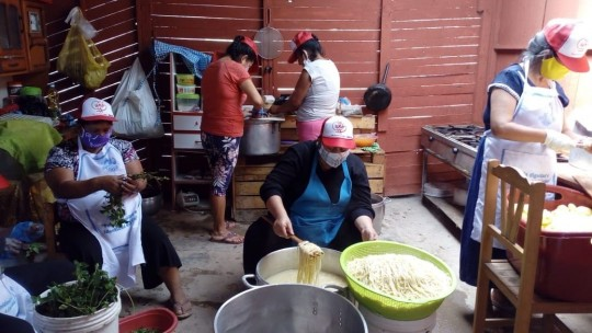 a group of women cooking.